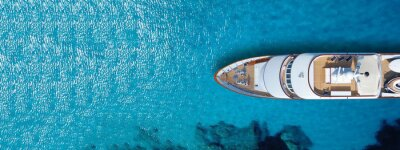 Plakat Aerial drone top down ultra wide photo of luxury yacht anchored in tropical exotic island turquoise sea