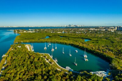 aerial drone view of boats in Key Biscayne with downtown Miami skyline in the back