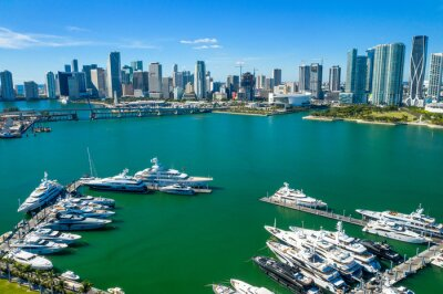 aerial drone view of boats with downtown Miami skyline in the back