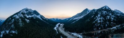 Plakat Aerial Panoramic View of a scenic Highway passing in the Canadian Mountain Landscape during a colorful spring sunset. Taken near Hope and Merritt, British Columbia, Canada.