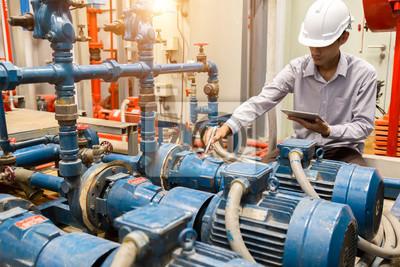 Plakat Asian engineer maintenance checking technical data of  system equipment Condenser Water pump and pressure gauge ,  water pump.
