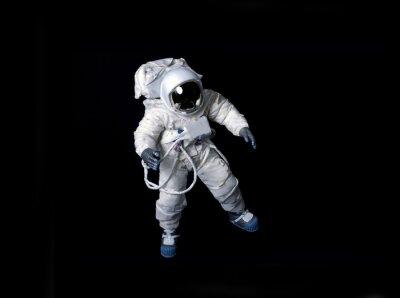 Plakat Astronauta pływających na czarnym tle.