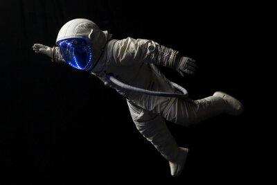 Plakat Astronauta w misji kosmicznej, w ciemności i przestrzeni