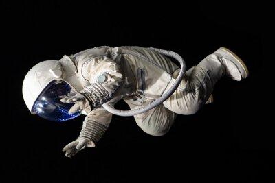 Plakat astronautów na czarnym tle