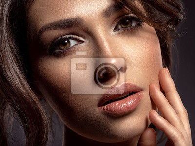 Plakat Beautiful woman with brown hair. Attractive model with brown eyes.