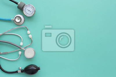 Plakat Blood pressure meter and stethoscope on blue background