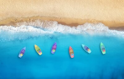 Plakat Boats from air. Aerial view on sea in Turkey. Summer seascape with clear water and sandy beach in sunny day. Top view of boats from drone. Summer seascape from air. Travel - image