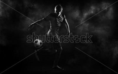 Plakat bright soccer playerl on the black background