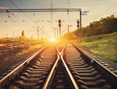 Plakat Cargo platforma kolejowa o zachodzie słońca. Kolej na Ukrainie. sta kolejowy