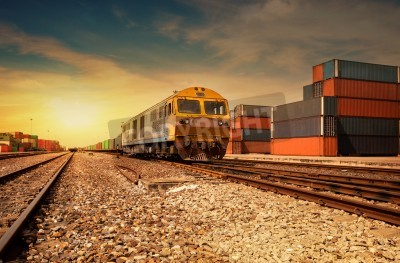 Plakat Cargo train platform at sunset with container