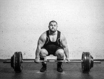Plakat Champion Powerlifter o silnych ramionach podnoszenia ciężarów
