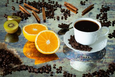 Plakat Coffee with cinnamon sticks, orange and kiwi in a cup