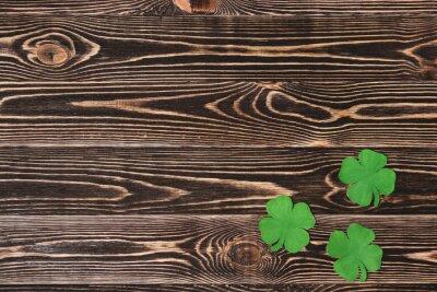 Plakat Cztery liść koniczyny na tle drewniane
