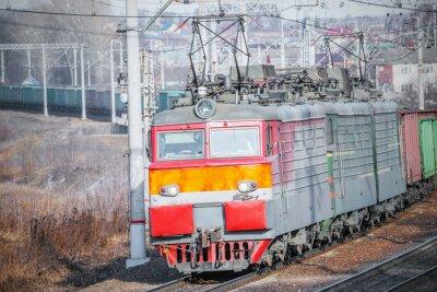 Plakat Długi pociąg towarowy.