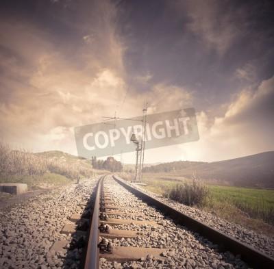 Plakat Długie kolejowe na wschód słońca
