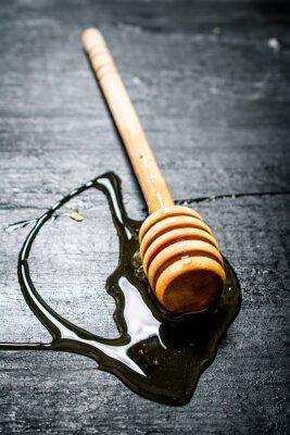 Plakat Drewniana łyżka słodkiego miodu naturalnego.
