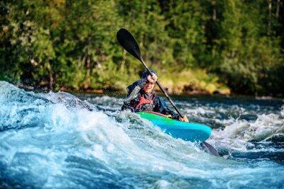 Plakat Extreme sport rafting whitewater kayaking. Guy in kayak sails mountain river