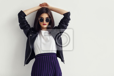 Plakat Fashion portrait of a young woman in leather jacket.