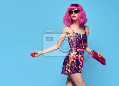 Plakat Fashionable female model with Pink Hair, Trendy Sunglasses. Stylish Party Glamour Outfit. Young Beautiful European girl Posing in Studio. Gorgeous fashion woman