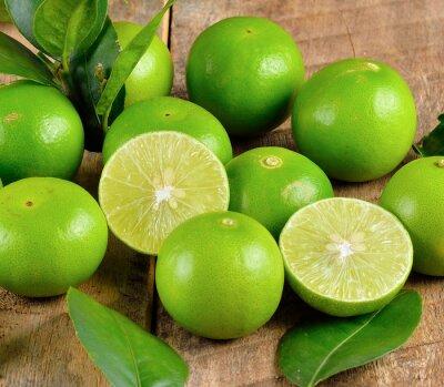 Plakat Fresh lime  on wooden  background