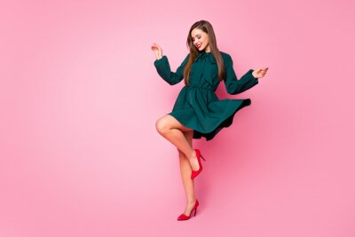 Plakat Full length photo of charming chic lady cheerful good mood dancing students event festive wear short green dress red high-heels isolated pastel pink color background
