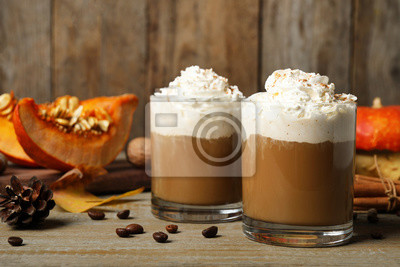 Plakat Glasses with tasty pumpkin spice latte on wooden table
