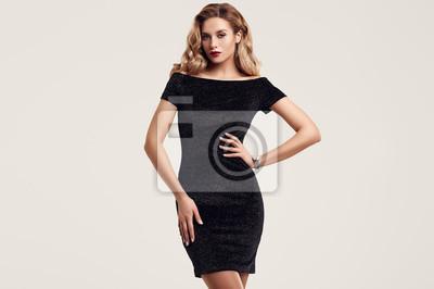 Plakat Gorgeous elegant sensual blonde woman wearing fashion black dress