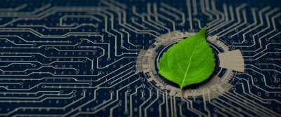 Plakat Green leaf on the converging point of computer circuit board. Nature with Digital Convergence and Technological Convergence. Green Computing, Green Technology, Green IT, csr, and IT ethics Concept.