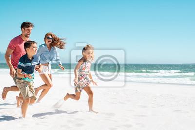 Plakat Happy family running on beach