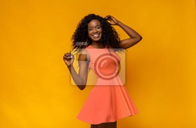 Plakat Joyful african girl in summer dress turning around