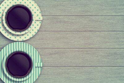 Plakat Kilka kubków kawy na drewnianym stole