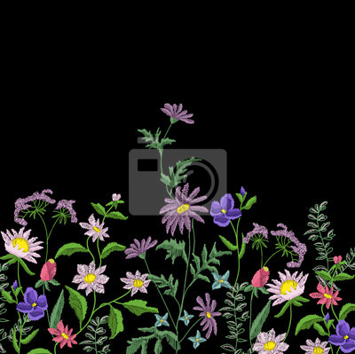 Kwiaty haftowane. Haftowane elementy projektu z kwiatów i liści na czarnym tle.