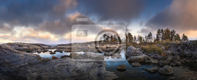 Plakat Moody sunset over northern shore with dramatic sky. Scandinavian scenic view