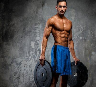 Plakat Muskularny facet w niebieskim spodenki
