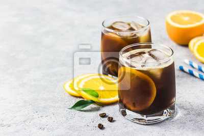 Plakat Orange spiced cold brew coffee. Selective focus, space for text.