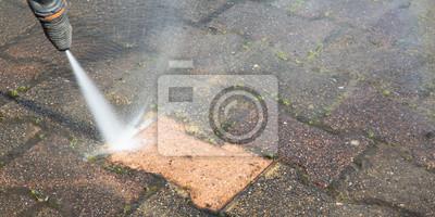 Plakat Outdoor floor worker cleaning with high pressure water jet