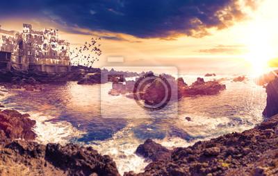 Paisaje pintoresco de mar y costa en Tenerife,islas canarias,España.Rocas y olas del mar con puesta de sol en el Puerto de la cruz