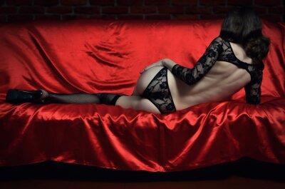 Plakat Piękna i seksowna młoda kobieta w erotycznej bieliźnie i pończochach