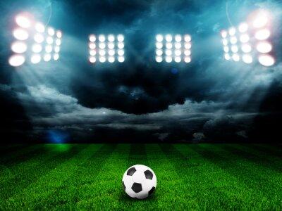 Plakat Piłka na polu stadionu ze światłem