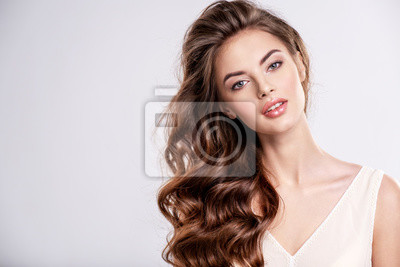 Plakat Portrait of a beautiful woman with a long brown hair.