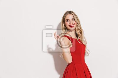 Plakat Portret uśmiechnięta młoda kobieta w czerwonej sukience