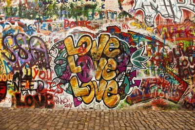 Plakat Prague, Czech Republic - October 7, 2010: A section of the Lennon Wall in the Little Town area of Prague near the Charles Bridge. This landmark wall is open to public graffiti in remembrance of John L