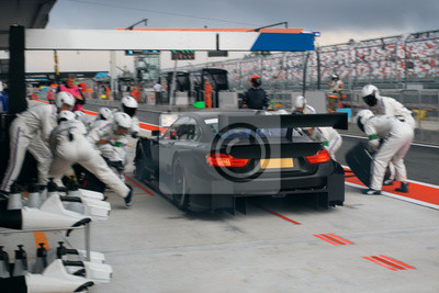 Plakat Race car on the pit stop in motion