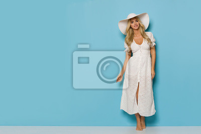 Plakat Relaxed Pretty Woman In White Summer Dress And Sun Hat