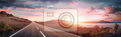 Plakat Road Trip - Scenic Landscape With Highway At Sunrise
