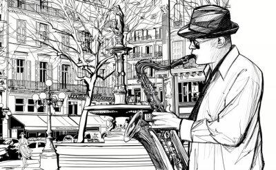 Plakat saksofonista w paryskiej ulicy