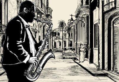 Plakat saksofonista w ulicy Kuby