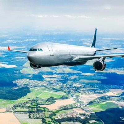 Plakat Samolot pasażerski na niebie