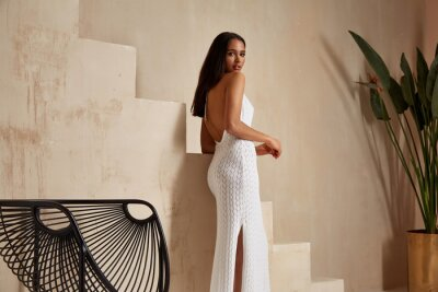 Plakat Sexy beautiful woman brunette tanned skin makeup cosmetic fashion clothes summer collection white cotton dress accessory bag style summer journey walk date beach wear interior stairs leaves flowerpot.