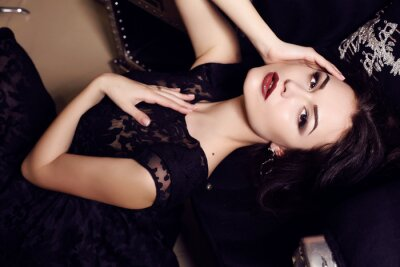 Plakat sexy  woman in black dress posing in luxurious interior